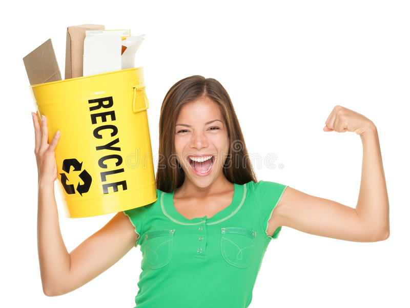 Recycling woman concept. Recycle woman holding recycling bin with paper showing muscles. Funny recycle concept isolated on white background. Asian / Caucasian royalty free stock photo