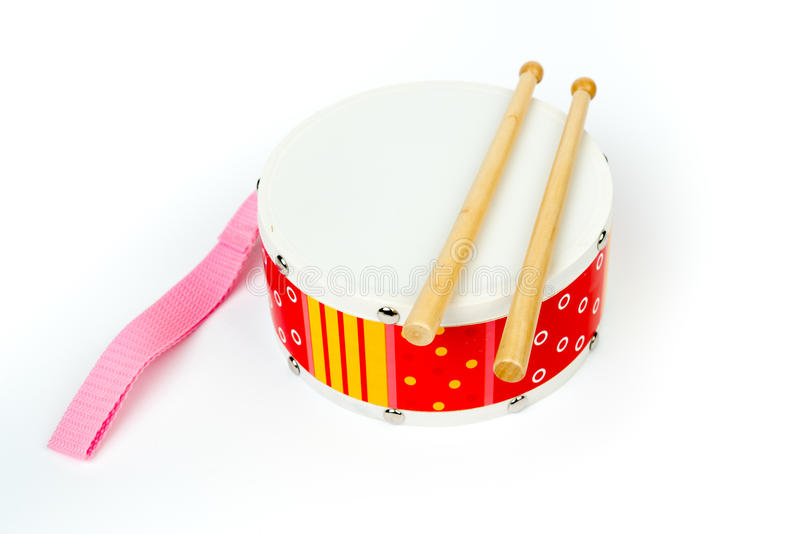 Red – yellow drum with drum sticks isolated on white background. Musical instrument, Drum toy for kids. Top, side view, royalty free stock photography