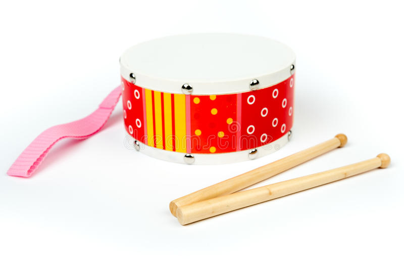 Red – yellow drum with drum sticks isolated on white background. Musical instrument, royalty free stock images