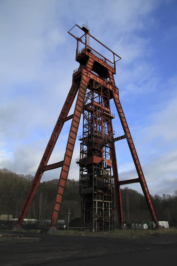 Red abandoned headframe Sainte Fontaine Moselle stock photography