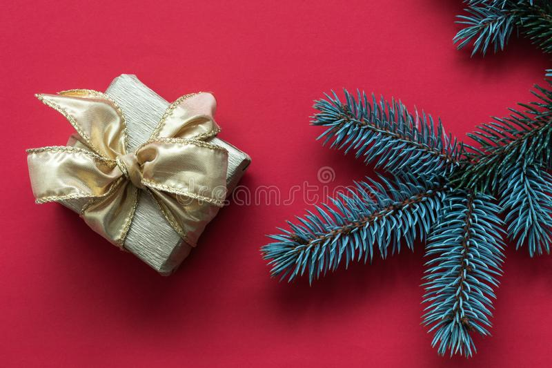 Red abstract Christmas background with Gift box and Christmas tree twigs royalty free stock images