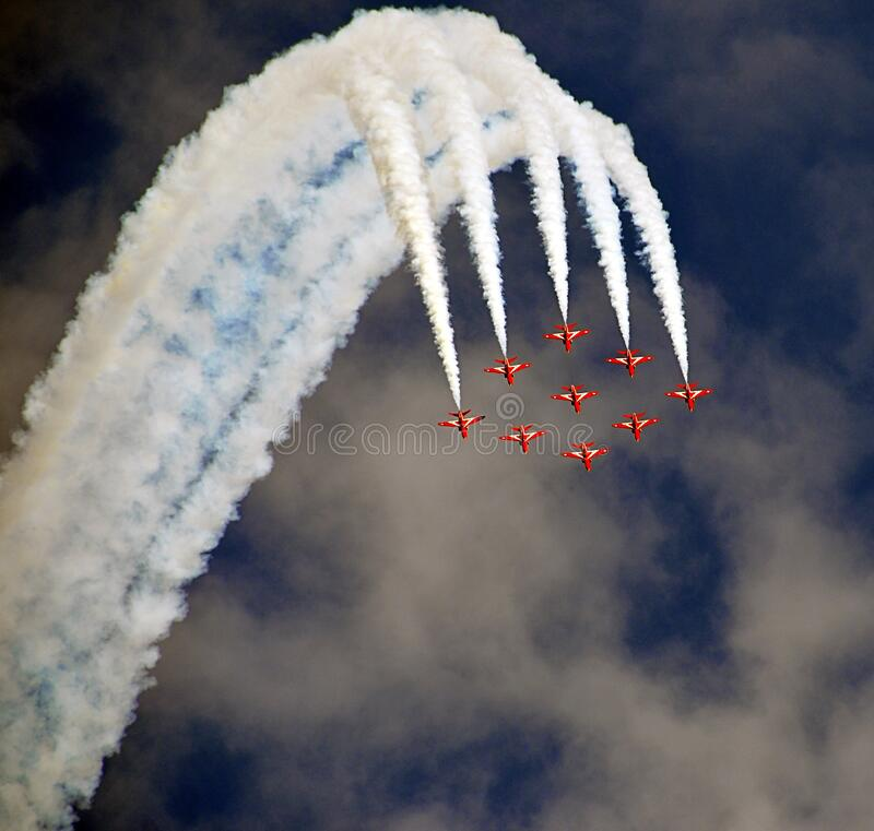Red Acrobat Planes Flying During Daytime royalty free stock photos