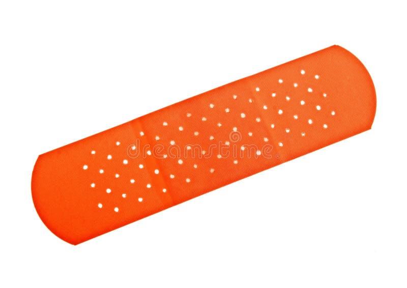 Red adhesive bandage on a white background stock photo