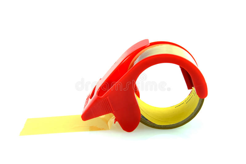 Red adhesive tape roll dispenser royalty free stock images