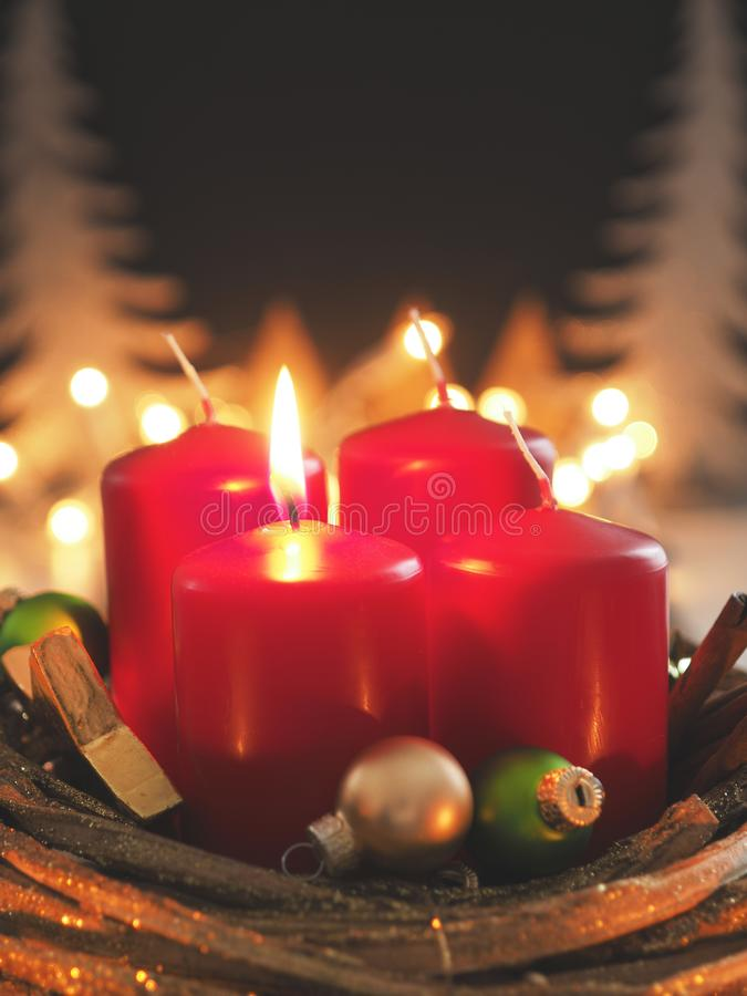 Red Advent candles. With decoration in a dark room, space for text or image stock photography