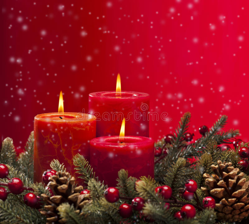 Red advent wreath with candles. Red advent flower arangement with burning candles royalty free stock photos