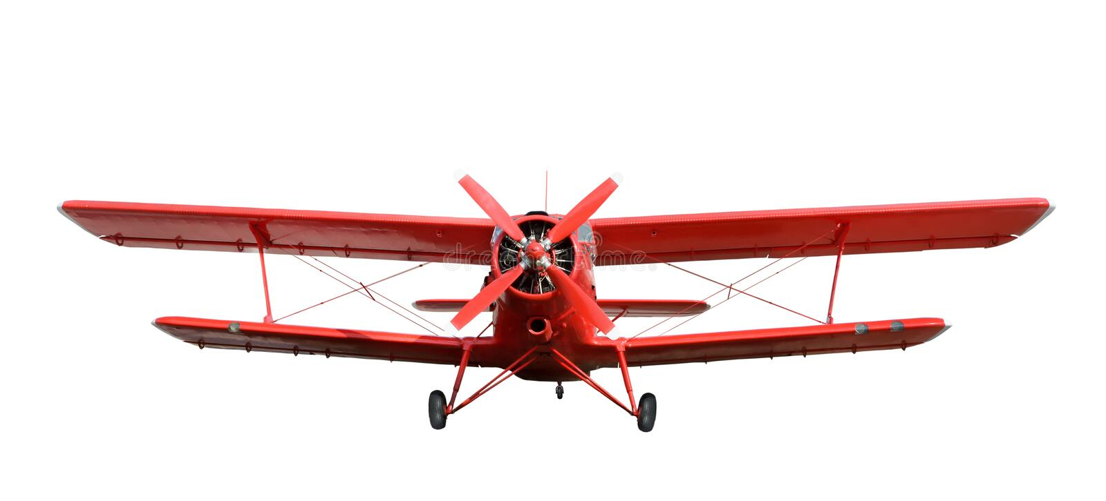 Red airplane biplane with piston engine. Front view of red airplane biplane with piston engine and propeller. Isolated on a white background royalty free stock photography