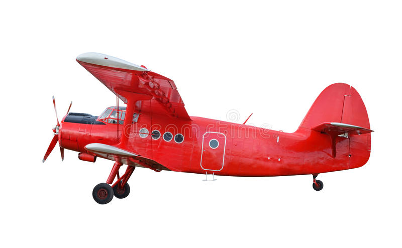 Red airplane biplane with piston engine. Side view of red airplane biplane with piston engine and propeller. Isolated on white background stock photography