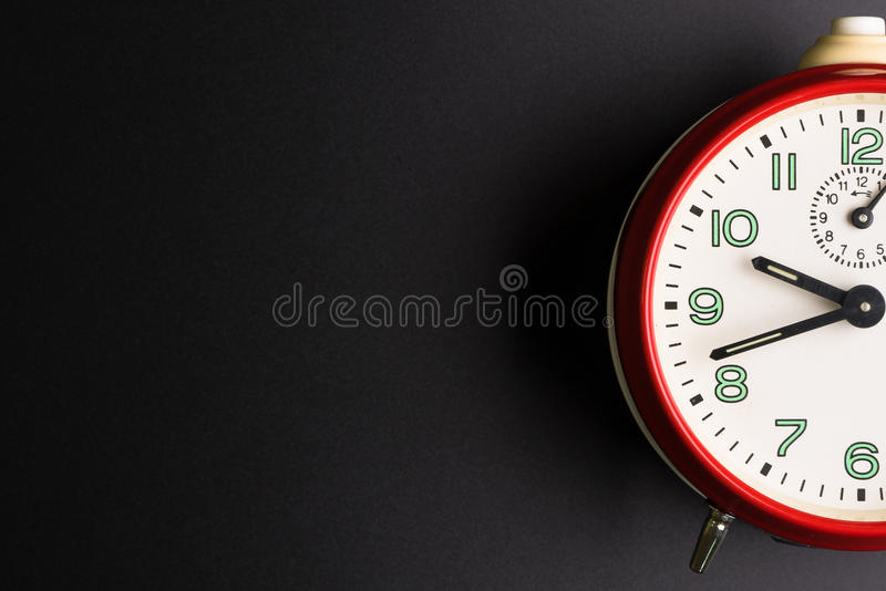 Red alarm clock on black background, Time concept, Rush. Hour concept, Copy space image for your text, Flat lay stock photo