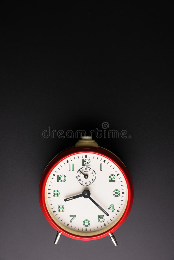 Red alarm clock on black background, Time concept, Rush. Hour concept, Copy space image for your text, Flat lay stock photography