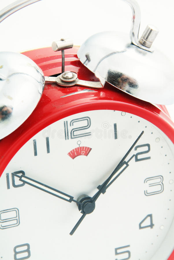 Red alarm clock closeup. Red alarm clock on white background, closeup detail on bell royalty free stock images