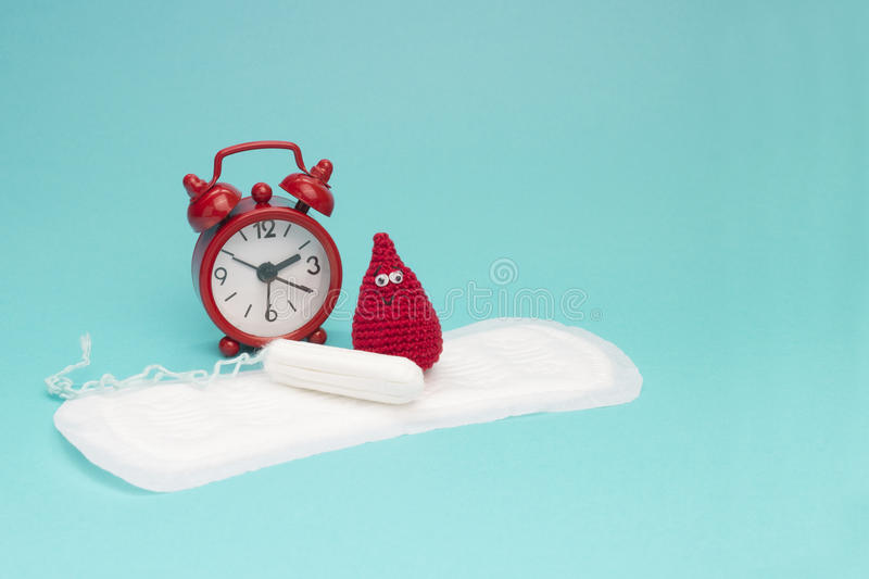 Red alarm clock, dreamy smile crochet blood drop, daily menstrual pad and tampon. Menstruation sanitary woman hygiene. Woman criti. Red alarm clock, dreamy smile stock images