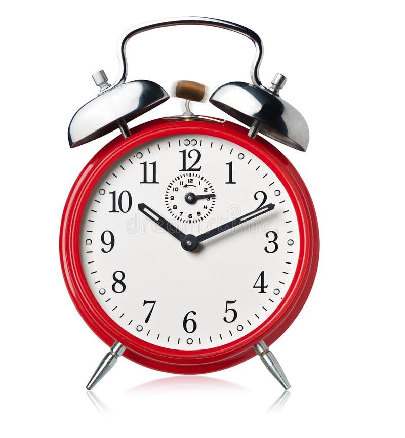 Red alarm clock, ringing. royalty free stock image