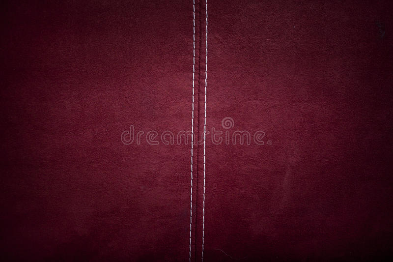 Red alcantara. Leather background texture with stitching stock images