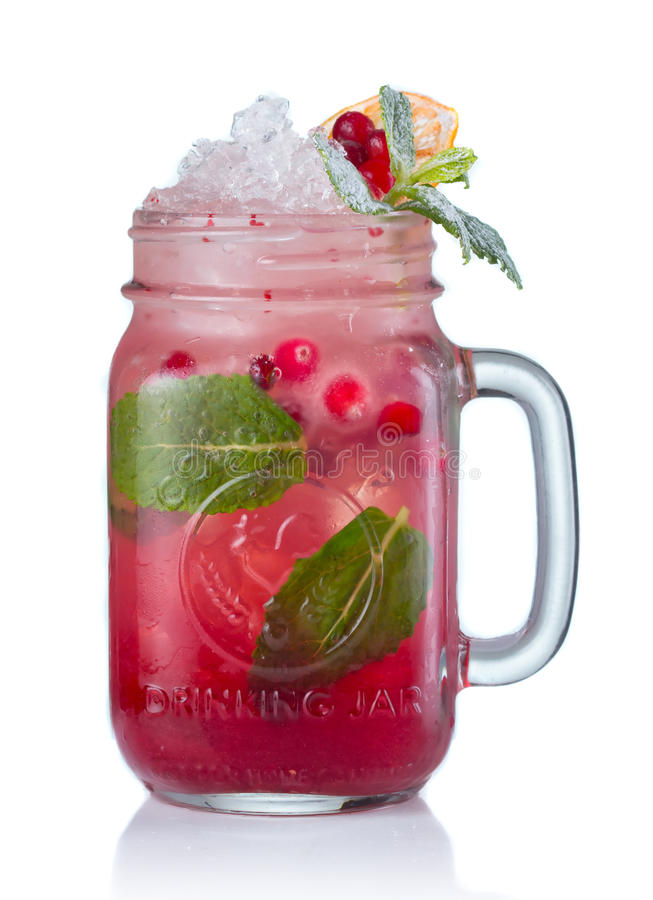 Red alcohol cocktail with cranberries in jar isolated royalty free stock image