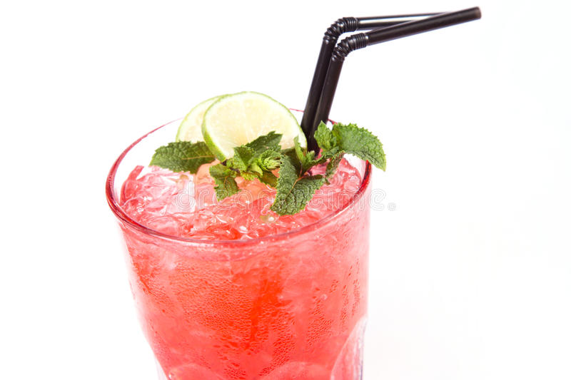 Red alcoholic cocktail. In transparent glass with lemon and mint stock image