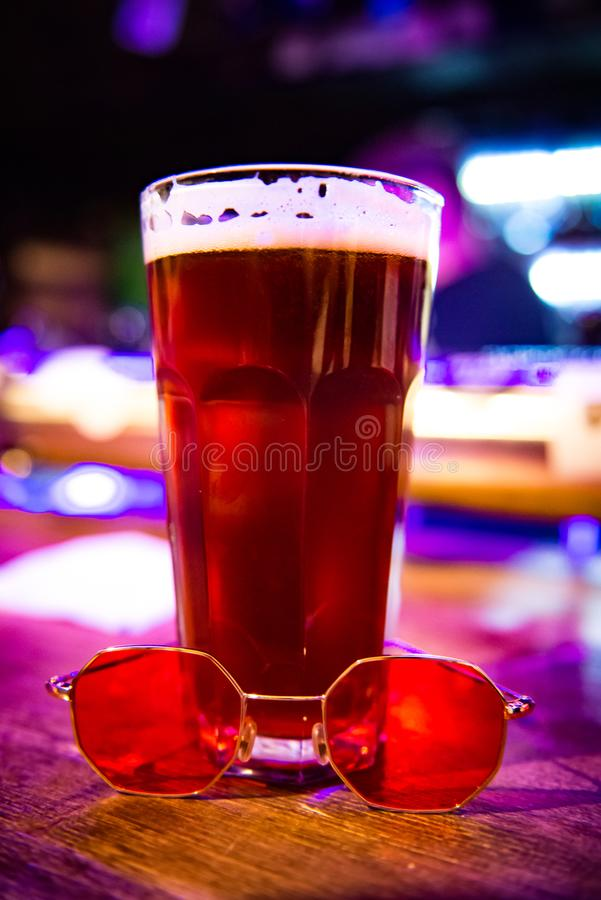 Red ale. Photo of red ale in a glass in a bar, beer culture, craft beer, pint of beer, rest on Friday evening stock photo