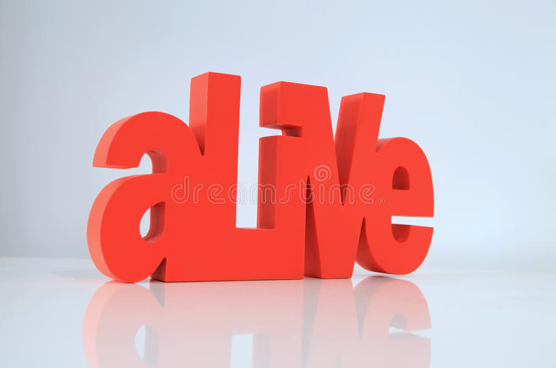 Red Alive wording on white background royalty free stock photography