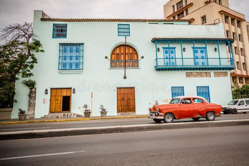 Red American Car in Havana, Cuba. Old red American car driving urban Cuban capital city royalty free stock images