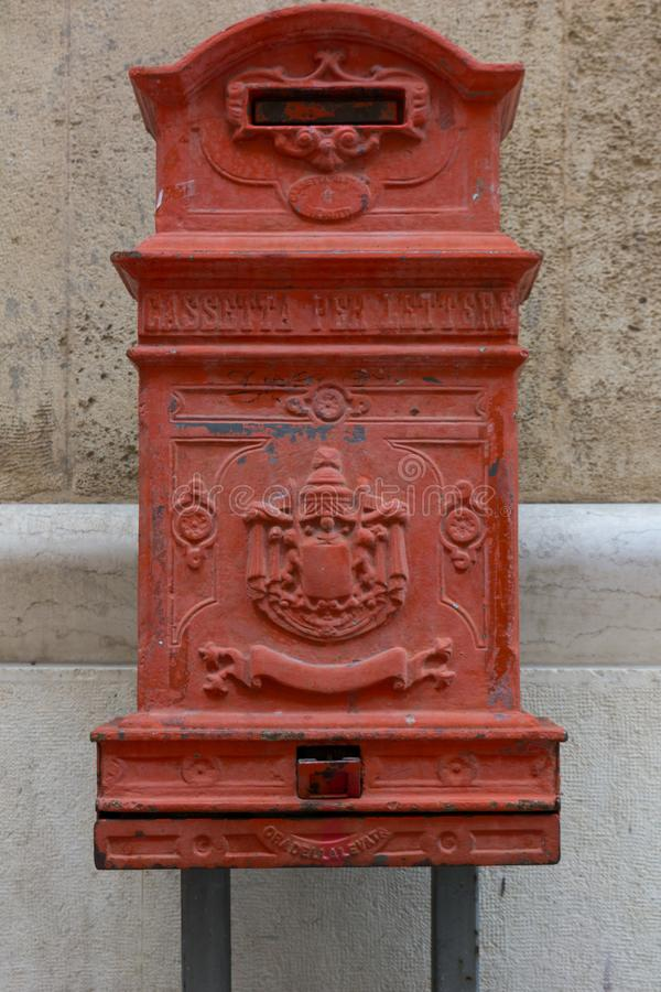 Red Ancient Letter Box in the City of Matera on Blur Background. Copy Space royalty free stock photos