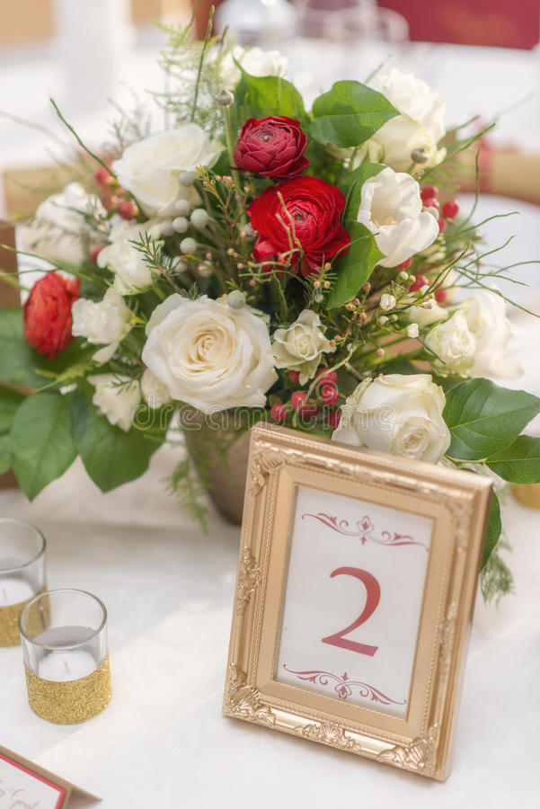 Free Red And Ivory Floral Arrangement Prepared For Reception, Wedding Table With Candle And Setting, Winter Concept Royalty Free Stock Image - 88415916