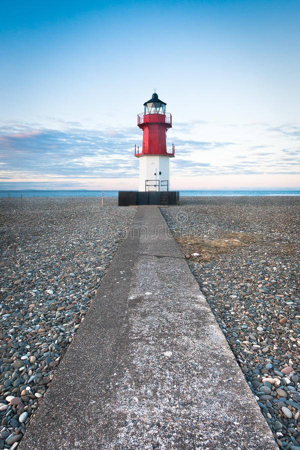 Free Red And White Lighthouse At The End Of A Path Stock Images - 33300054