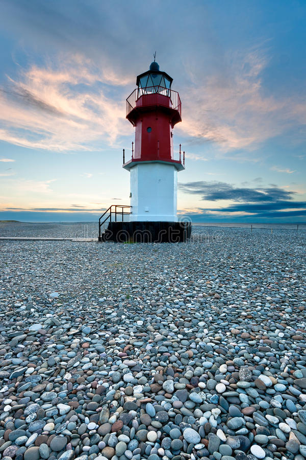 Free Red And White Lighthouse On A Beach With Pebbles Stock Photography - 33300062
