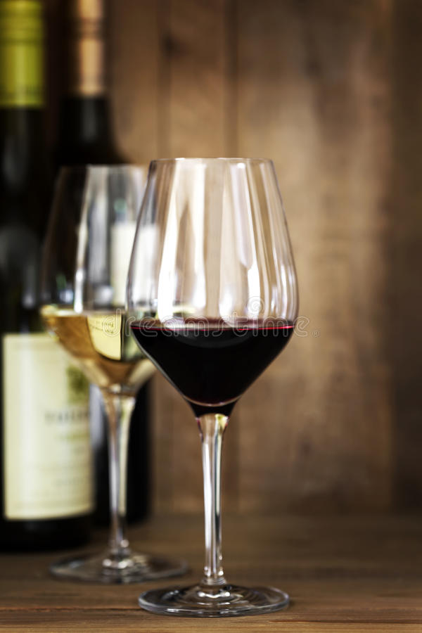 Free Red And White Wine Glasses And Bottles Over Oak Stock Photo - 30400080