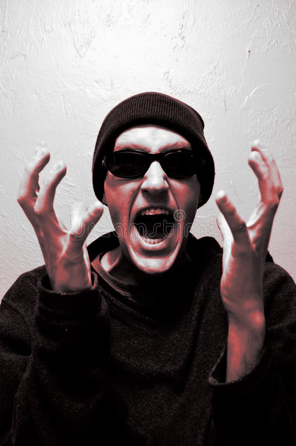 Red with Anger. Man screaming and throwing up hands in anger stock photos