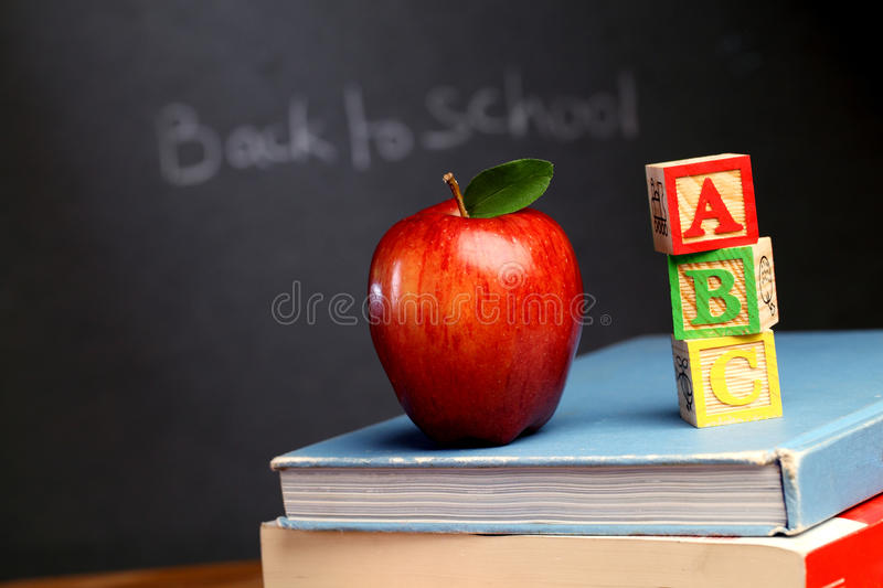 Red apple and ABC cubes royalty free stock photos