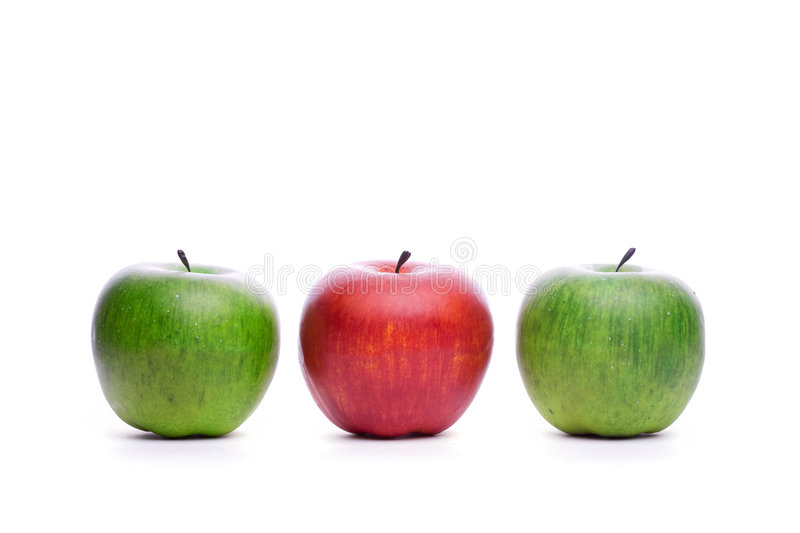 Red apple beetween green apples royalty free stock photos