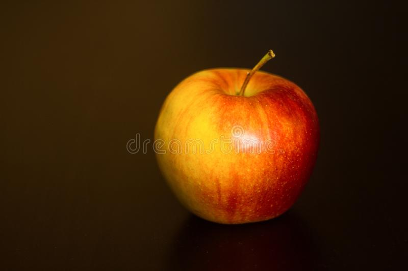 Red apple on black background stock images