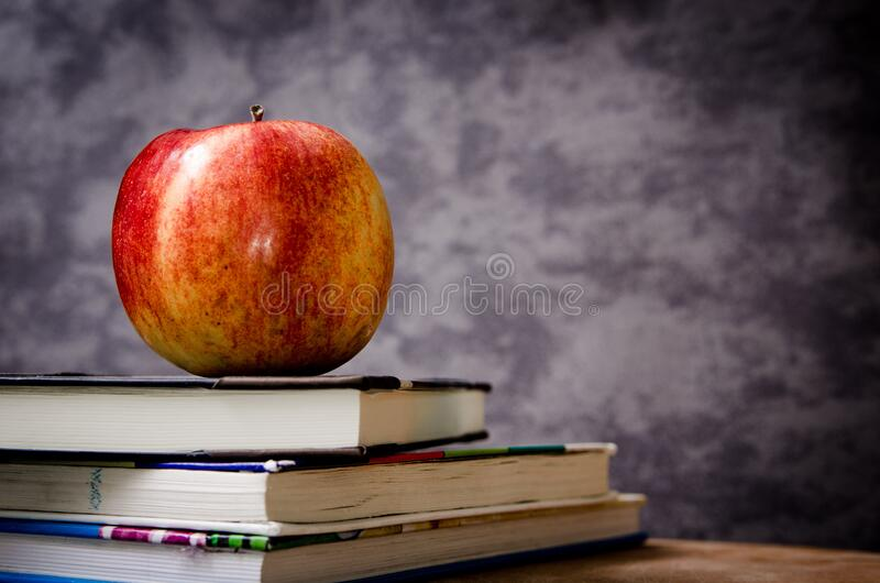 Red Apple On Black Book Free Public Domain Cc0 Image