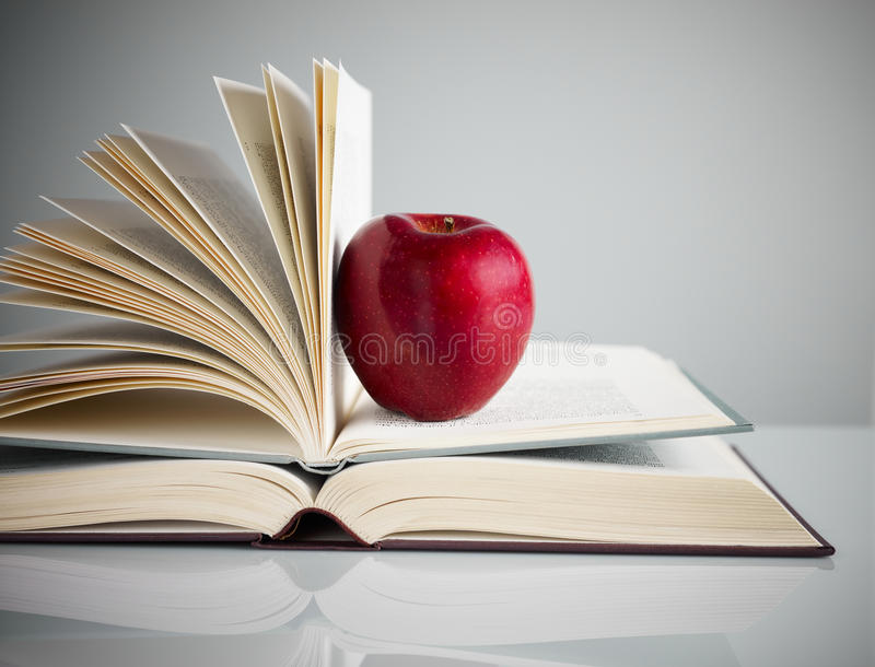 Red apple on books royalty free stock image