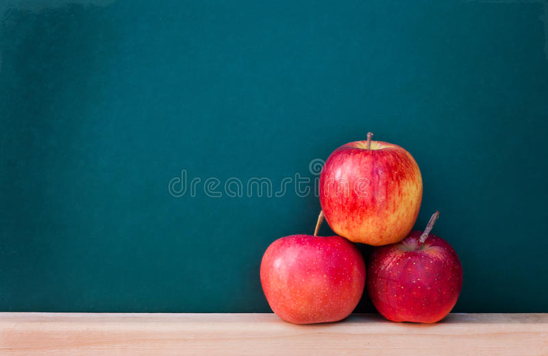 Red apple on chalkboard royalty free stock photos