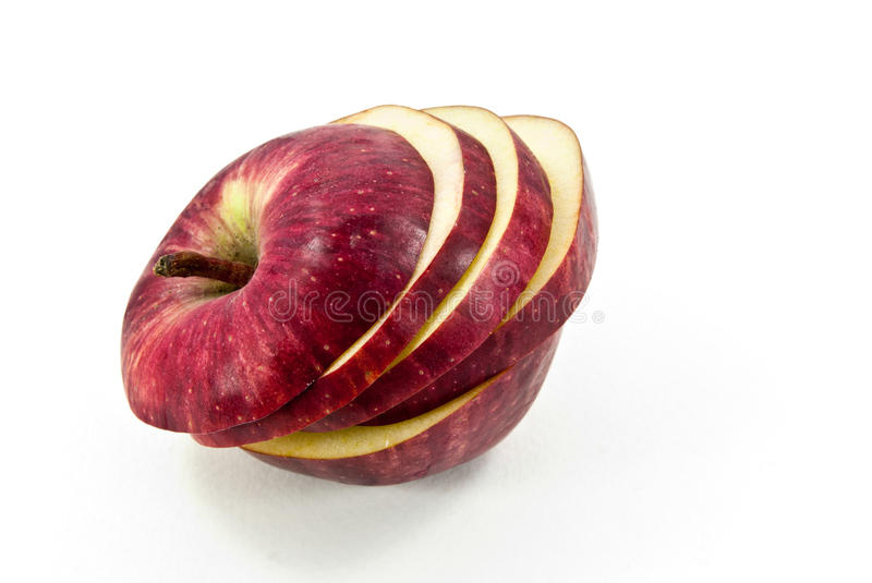Red apple cut. Sliced of red apple shot on white background stock photography