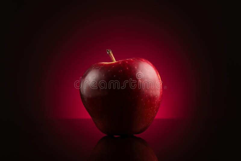 Download Red Apple On Dark Red Background Stock Image - Image: 11817105