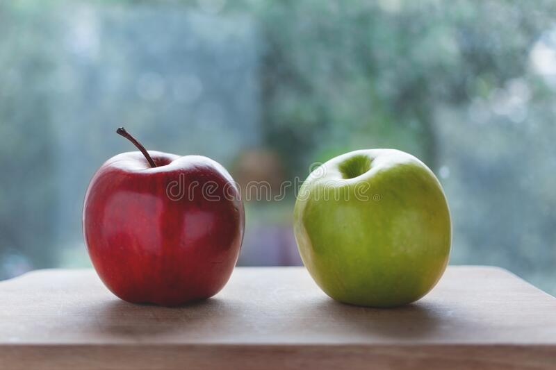 Red Apple Beside the Green Apple royalty free stock images