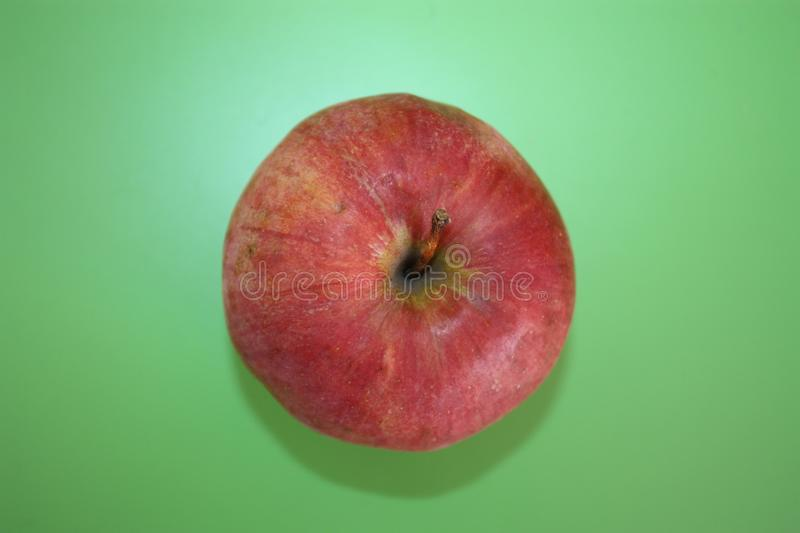 Red apple on a green table stock images
