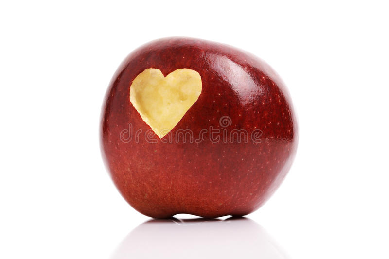 Red apple with heart symbol stock image