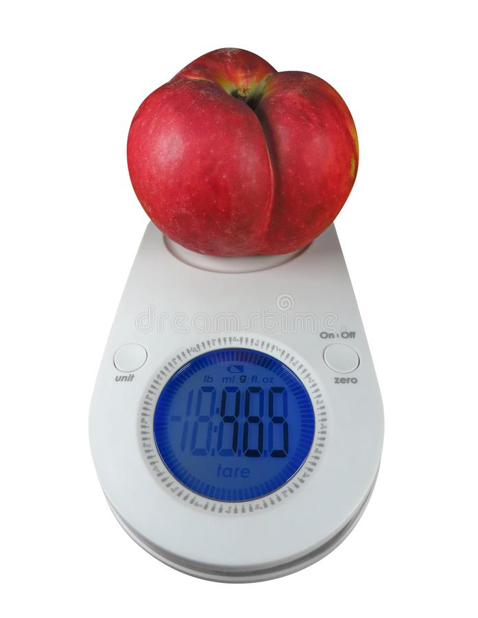 Red apple on kitchen scales. Isolated on white. Clipping Path included royalty free stock photo
