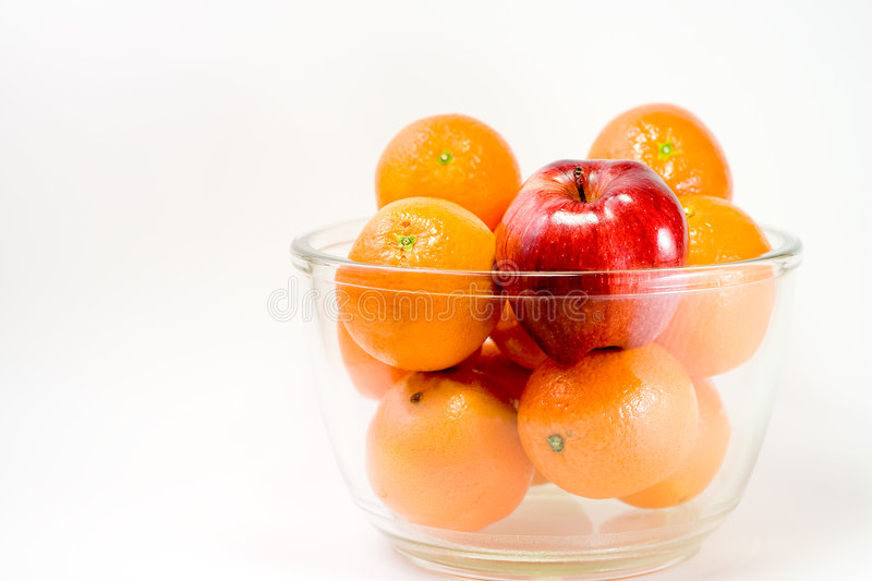 Download A Red Apple And Oranges In A Bowl Stock Image - Image: 8264161