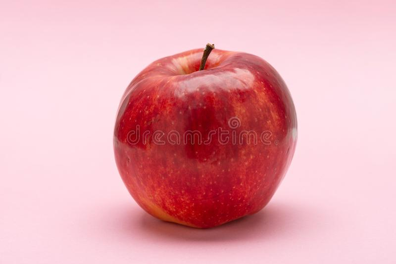 Red apple, on a pink background, Jonagold stock photography