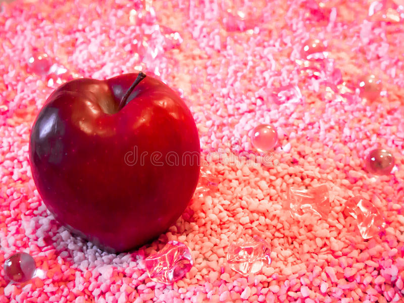 The Red Apple on Pink stock images