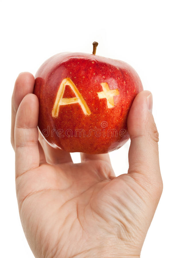 Red apple and A Plus sign stock photos