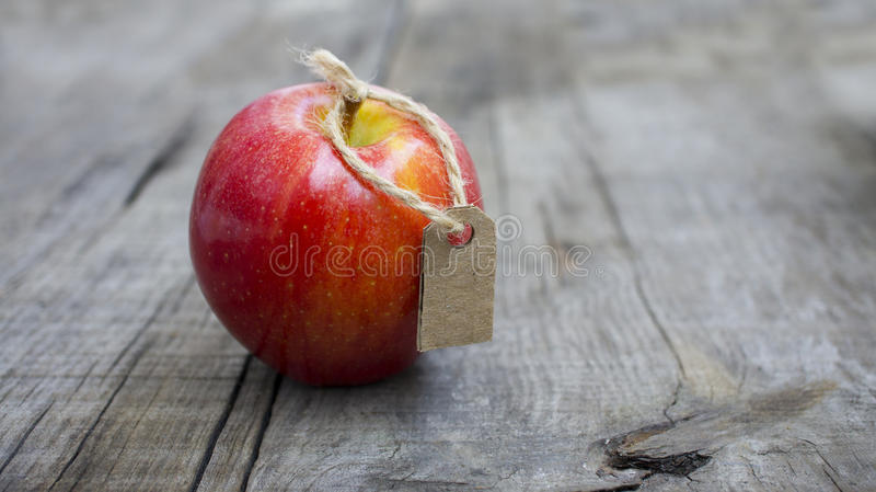 Red Apple with a Price Label royalty free stock photos