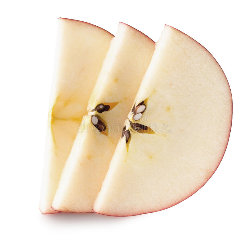 Red apple slices isolated on the white background.  stock images