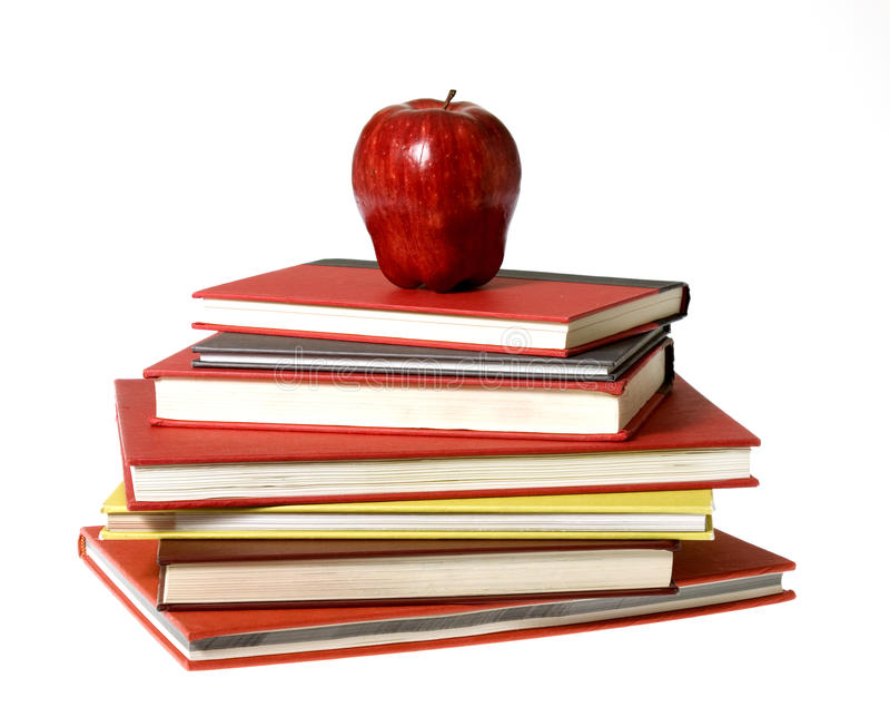 Red Apple on top of pile of Books stock photos