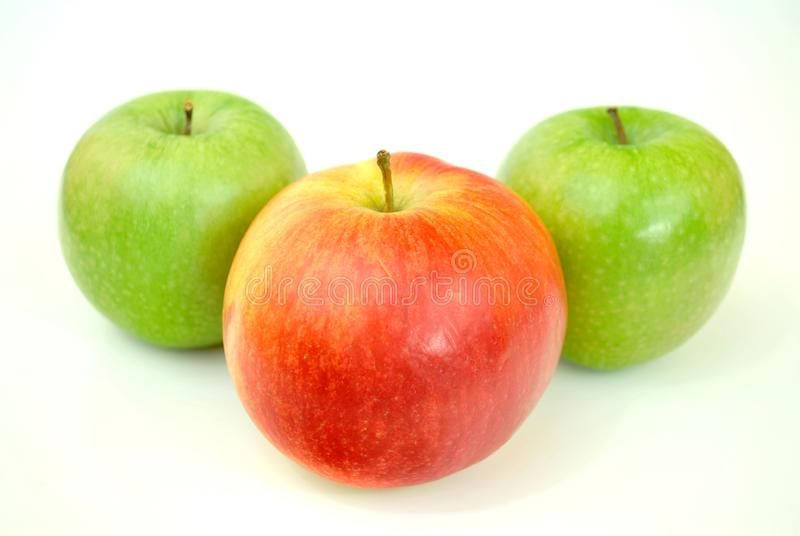Red Apple With Two Green Apples stock images