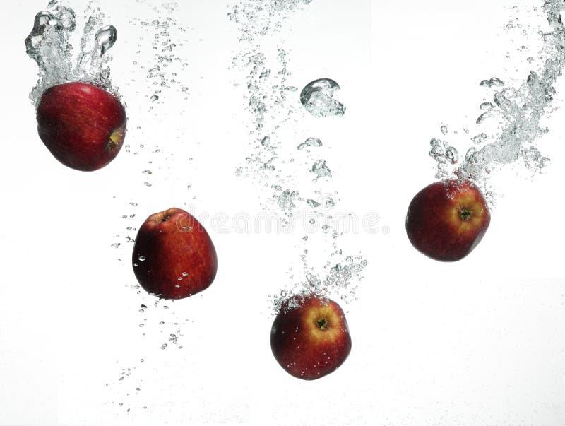 Download Red apple under water stock photo. Image of splashing - 10724880